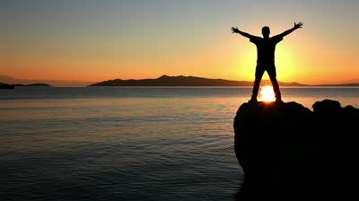 stock-footage-silhouette-of-a-man-practicing-yoga-at-the-sunset