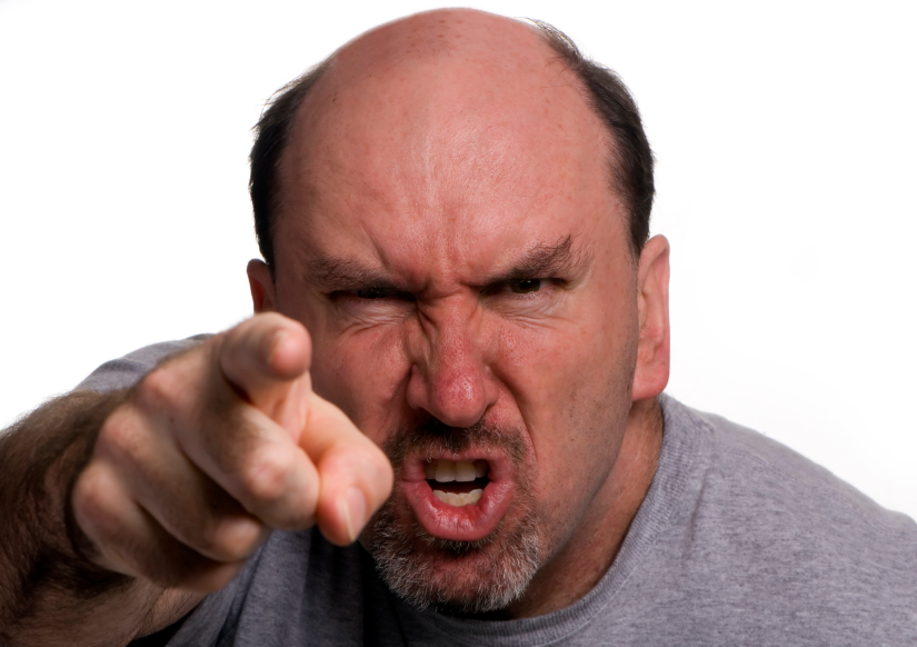 A 40 something man, in a rage during an argument