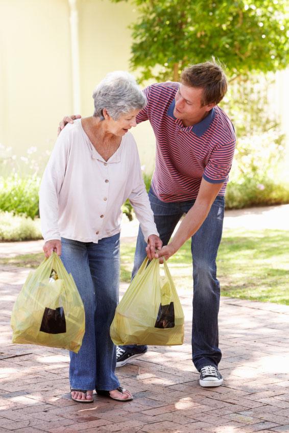 Man Helping Senior Woman With Shopping