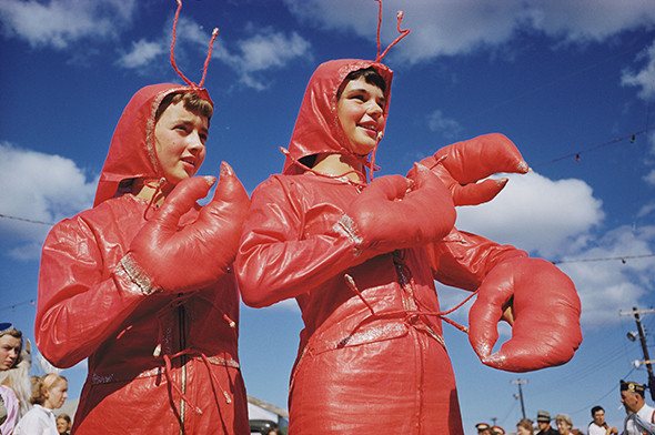 Two girls dressed as lobsters participate in the Lobster Festival.