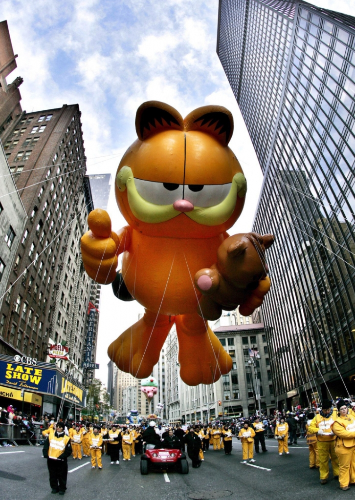 Mandatory Credit: Photo by Peter Foley/EPA/REX/Shutterstock (7589693g) 'Garfield the Cat' Floats Down Broadway at the Macy's 79th Annual Thanksgiving Day Parade in New York City Thursday 24 November 2005 Usa Macys Thanksgiving Parade - Nov 2005