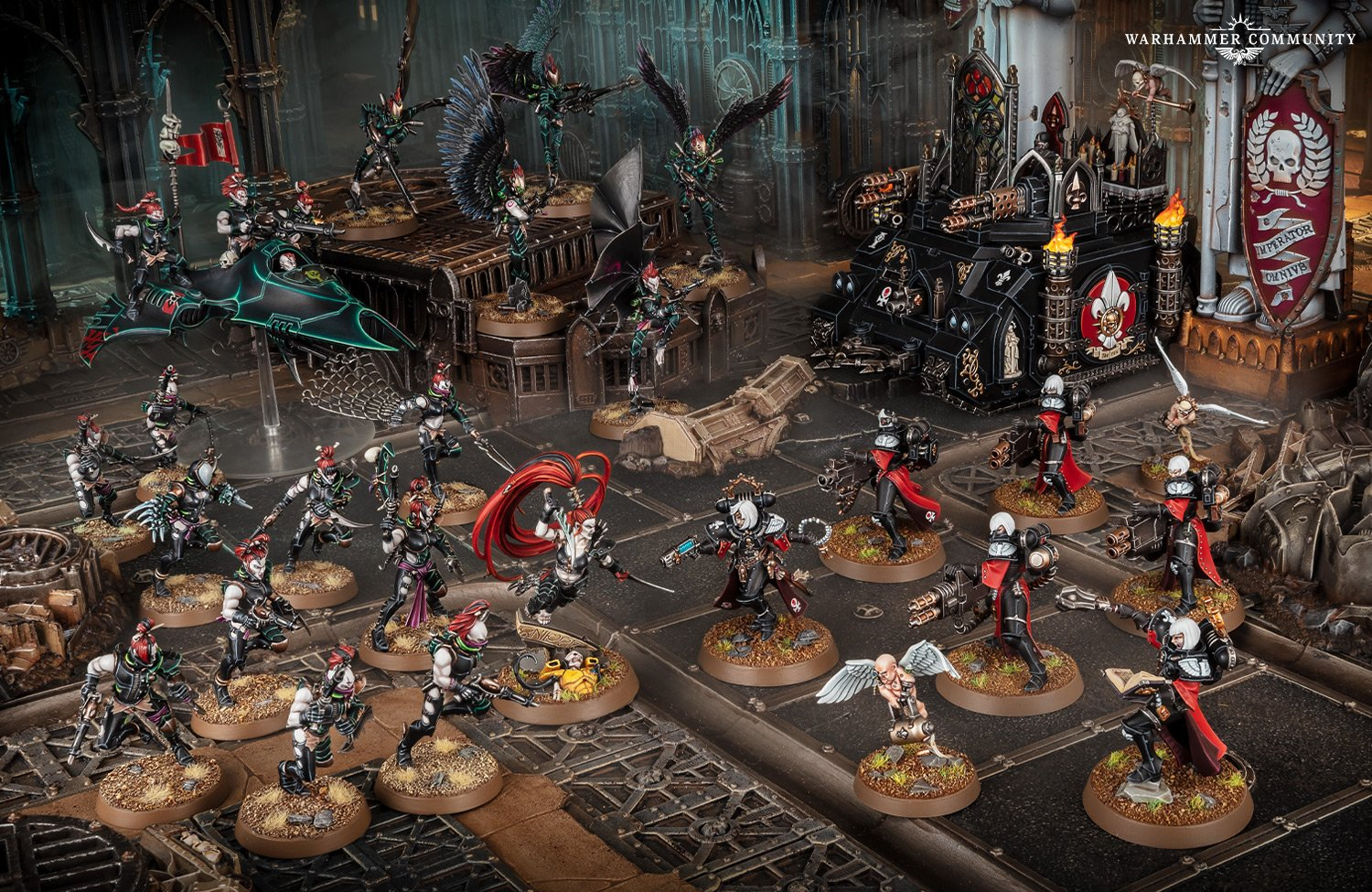 A force of Drukhari (elfin aliens) models fighting against Sisters Of Battle (armoured nuns, backed up by a battle tank).